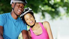 Young active African American couple enjoying bike ride outdoor - stock footage
