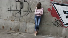 Upset depressed unhappy teenage girl aimlessly standing alone. - stock footage