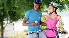 Young active African American couple taking selfie on smartphone outdoor - stock footage