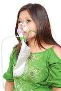 Woman with Oxygen Mask - stock photo