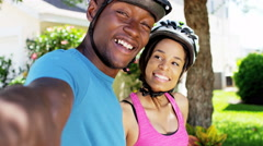 Young fitness African American couple cycling outdoor Stock Footage