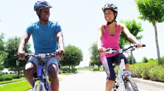 Young fitness African American couple enjoying biking outdoor - stock footage