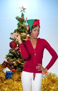 Black Woman Holding a Christmas Ornament - stock photo