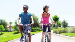 Young happy African American couple enjoying bike ride outdoors - stock footage