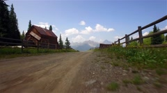 Driving on an old country road through a ghost town high in the mountains. - stock footage