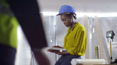 4k Confident female engineer or architect working at construction site Stock Footage