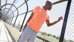 Young active African American guy doing fitness activity on bridge outdoor - stock footage