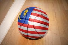 basketball ball with the national flag of malaysia - stock photo