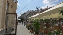 Sunny day on Nicolae Balcescu Street in Sibiu Stock Footage