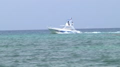 Boat floating Playa del Carmen Mexico Stock Footage