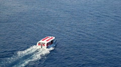 Life boat with the rescued passenger from the cruise shio approaches the shore Stock Footage