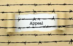 Appeal page against barbwire  concept - stock photo