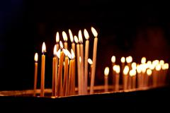 Candles in the Holy Sepulchre Church in Jerusalem - stock photo