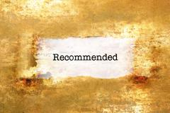 Stock Photo of Recommended text on grunge background