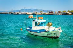 Fisherman's boat floating on clear water, Greece Stock Photos
