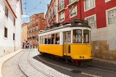tram on narrow street of Alfama, Lisbon - stock photo
