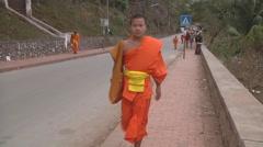 Buddhist monks walking in Luang Prabang, Laos Stock Footage