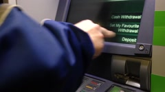Detail of a man's hand printing receipt at an ATM. Stock Footage