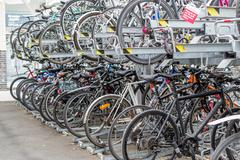 Stock Photo of Parked Rows of Commuter Bikes at a Train Station