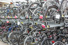 Stock Photo of Rows of Commuter Bikes at a Train Station