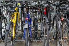 Stock Photo of Locked Rows of Commuter Bikes at a Train Station