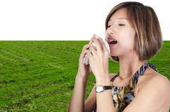 Asian Woman Blowing Nose - stock photo