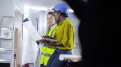 4k Female engineer or architect greets male colleague with a high five - stock footage