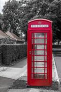Red Telephone Box with Blue Sky - stock photo