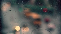 Rain drops on window with traffic in background ,rainy weather, Stock Footage