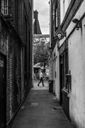 Dark Alleyway and Man Walking Stock Photos