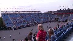 Time lapse people at tribune stadium Stock Footage
