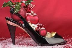High heels with Christmas decorations - stock photo