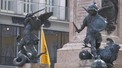 Little statues surrounding Mariensäule in Munich Stock Footage