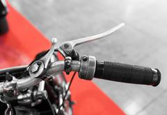 vintage motorcycle with gear lever on the handlebar - stock photo