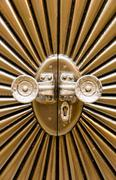 Metal door shaped sunburst. - stock photo