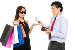 Shopaholic Wife Palm Out Money Reluctant Husband - stock photo