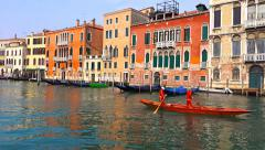 Rowing team training on small boat on Canal Grande in Venice - stock footage
