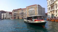 Grand Canal transportation with vaporeto waterbus and small boats - stock footage