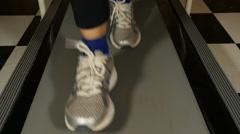 Woman's feet on treadmill Stock Footage