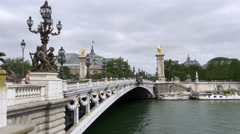 Boats passing under Pont Alexandre III Bridge - Paris France Stock Footage