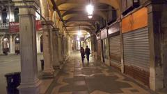 Tourist walk POV among palace posts coridor on San Marco square - stock footage