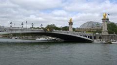 Tour boat passing under the Pont Alexandre III bridge - Paris France Stock Footage