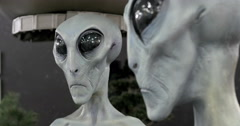 4K CU rack focus profile grey gray alien face in ufo museum Roswell NM Stock Footage