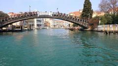 Tourist pov from waterbus vaporeto ride under Accademia bridge  in Venice Stock Footage