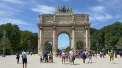 Tourists in front of the Arc de Triomphe du Carrousel - Paris France Stock Footage