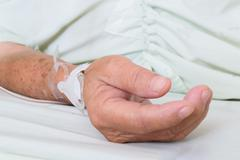 A patient in the hospital with saline intravenous - stock photo