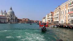 Gondolier with gondola at San Marco station on Grand Canal, venice Stock Footage