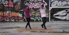 Male and Female Break Dancers in Urban Setting - stock footage