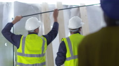 4k Female engineer or architect at building site surveys the space - stock footage