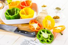Low calorie stuffed peppers with ground turkey and white rice. - stock photo